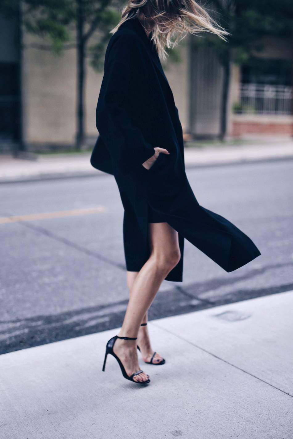 black coat with stuart weitzman nudist sandals