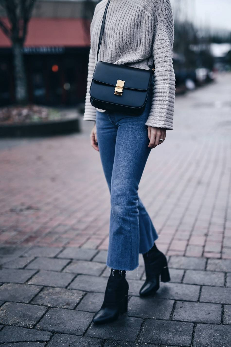 Style and beauty blogger Jill Lansky of The August Diaries Whistler travel diary in redone Leandra jeans Celine box bag 3.1 Phillip Lim Kyoto boots
