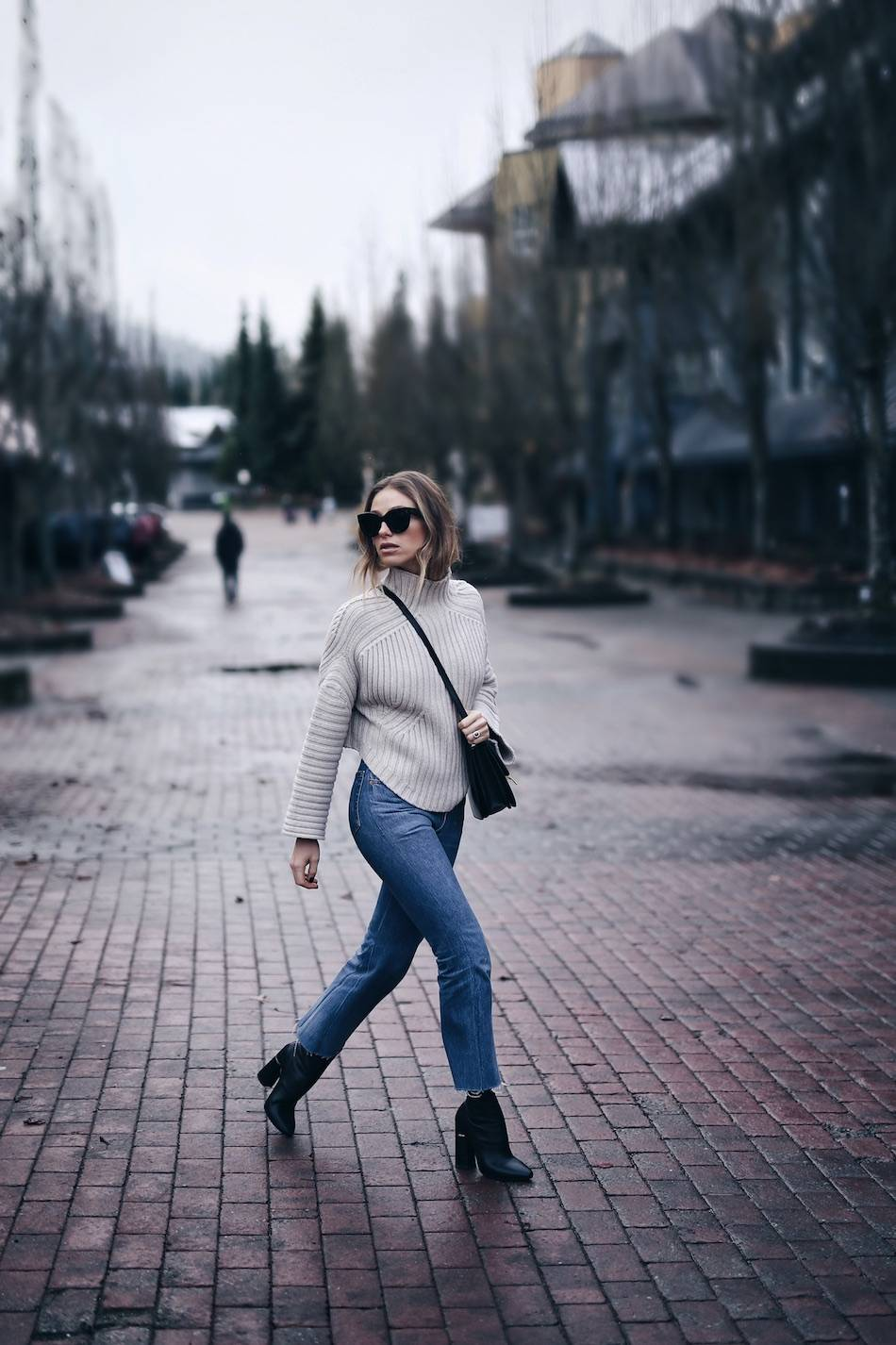 Style and beauty blogger Jill Lansky of The August Diaries Whistler travel diary in redone jeans turtleneck Celine box bag Celine Caty sunglasses