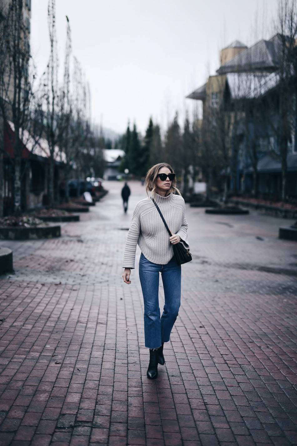 Style and beauty blogger Jill Lansky of The August Diaries Whistler travel diary in redone jeans, turtleneck and Celine box bag