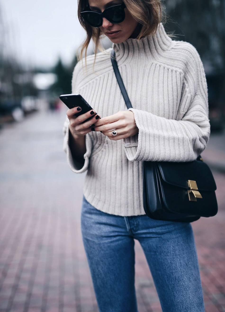 Style and beauty blogger Jill Lansky of The August Diaries Whistler travel diary in turtleneck Celine box bag black diamond engagement ring