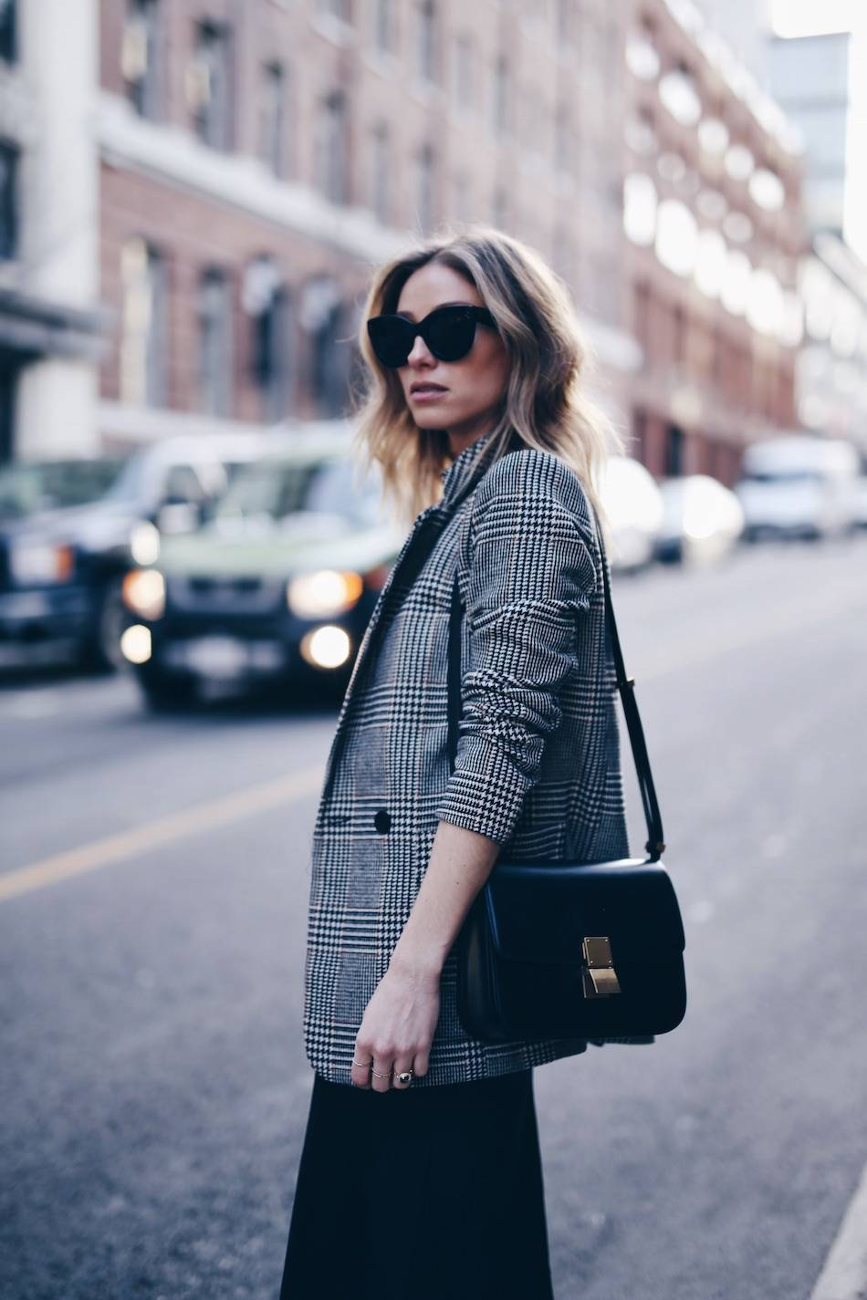Style and beauty blogger Jill Lansky of The August Diaries in street style plaid boyfriend blazer, Celine medium box bag