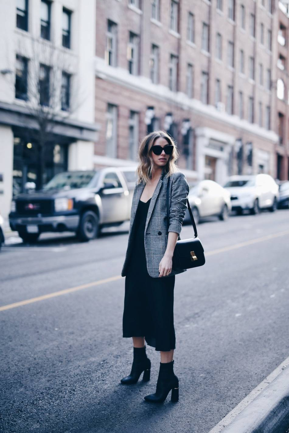 Style and beauty blogger Jill Lansky of The August Diaries on how to wear a slip dress in the winter in John Patrick Organic slip dress, H&M plaid boyfriend blazer, Celine accessories