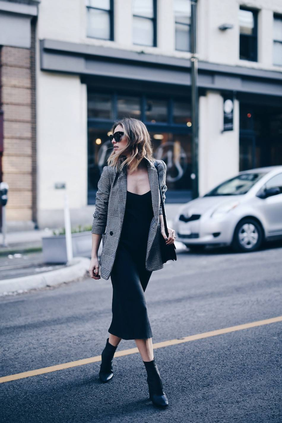 Style and beauty blogger Jill Lansky of The August Diaries on how to wear the perfect slip dress in John Patrick Organic slip dress, plaid boyfriend blazer, 3.1 Phillip Lim boots