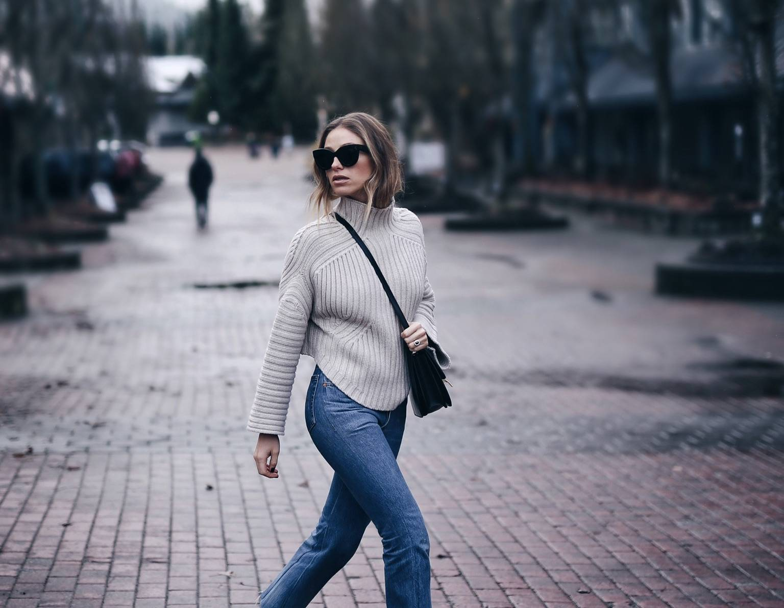 fi-Style and beauty blogger Jill Lansky of The August Diaries Whistler travel diary in redone jeans, turtleneck and Celine box bag