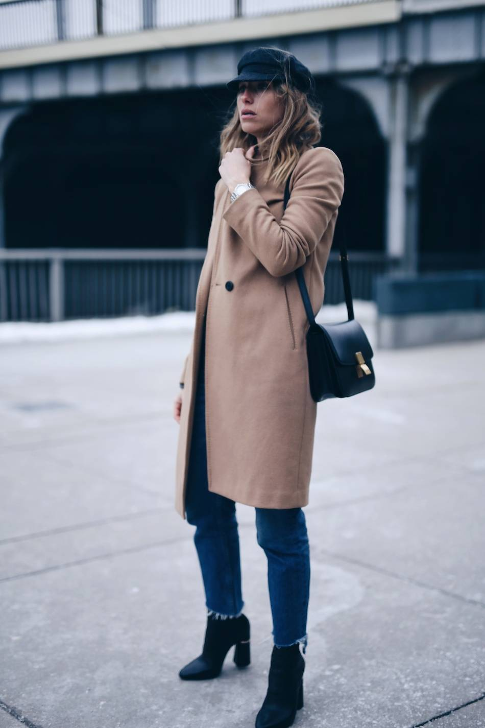 Style and beauty blogger Jill Lansky of The August Diaries Isabel marant Eva newsboy cap, camel coat, jeans, French style, how to dress like a Parisian, tag heuer watch