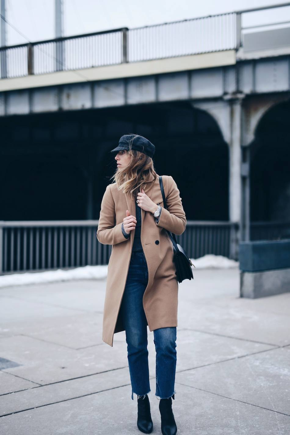 Style and beauty blogger Jill Lansky of The August Diaries Isabel marant Eva newsboy cap, camel coat, jeans, how to dress like a Parisian, tag heuer watch