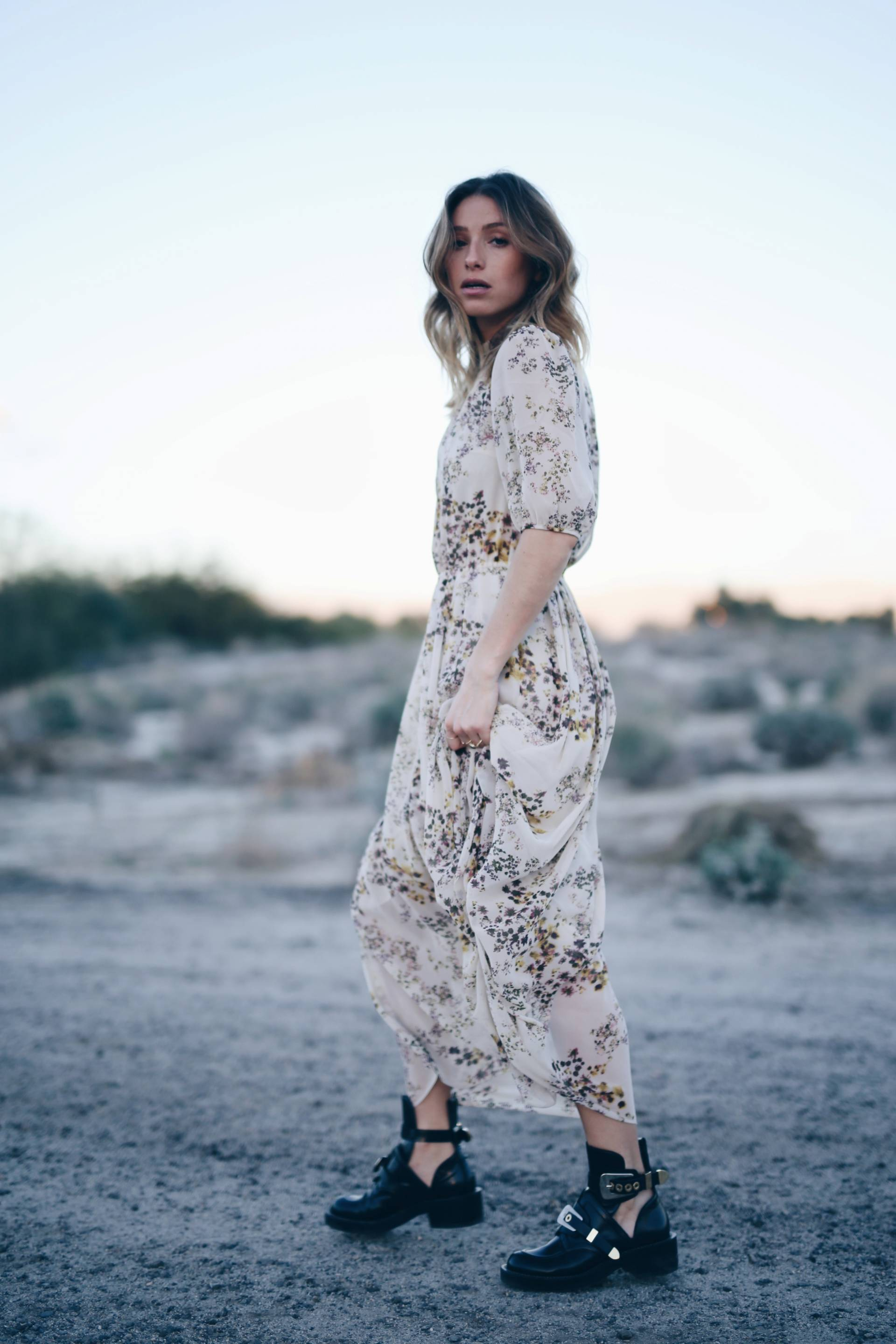 Style and beauty blogger Jill Lansky of The August Diaries in Aritzia silk boho dress, Balenciaga ceinture boots, Palm springs desert editorial