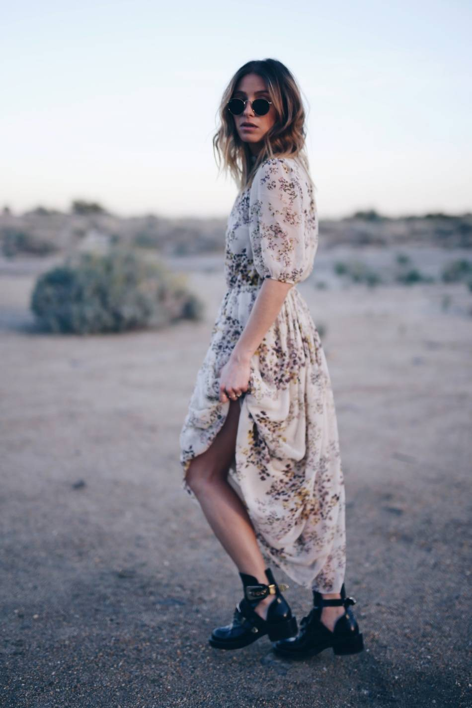 Style and beauty blogger Jill Lansky of The August Diaries in Aritzia silk dress Balenciaga boots, Palm springs desert editorial