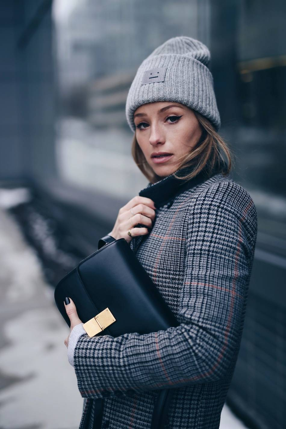 Style and beauty blogger Jill Lansky of The August Diaries on how to stay warm + stylish in the winter in Acne Pansy toque, cat eye makeup