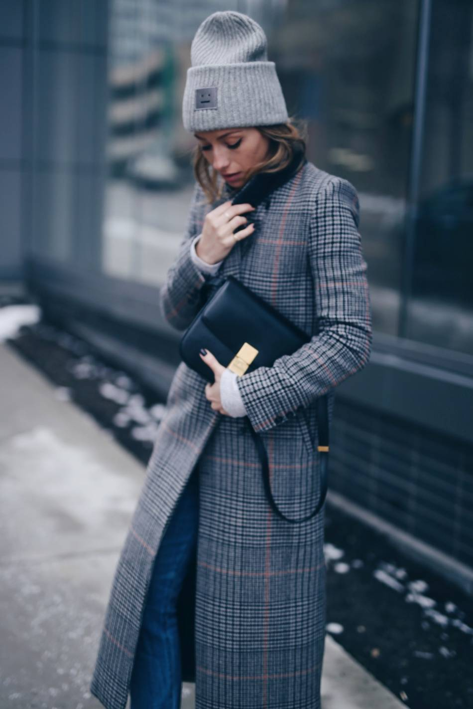 Style and beauty blogger Jill Lansky of The August Diaries on how to stay warm + stylish in the winter in Acne Pansy toque, plaid maxi coat, Celine black box bag