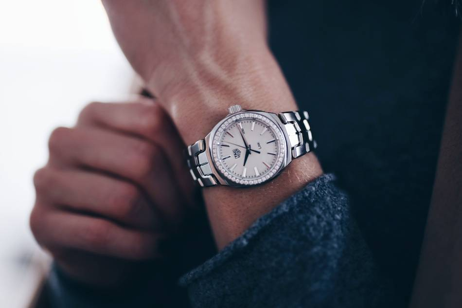 Style and beauty blogger Jill Lansky of The August Diaries tag heuer silver watch