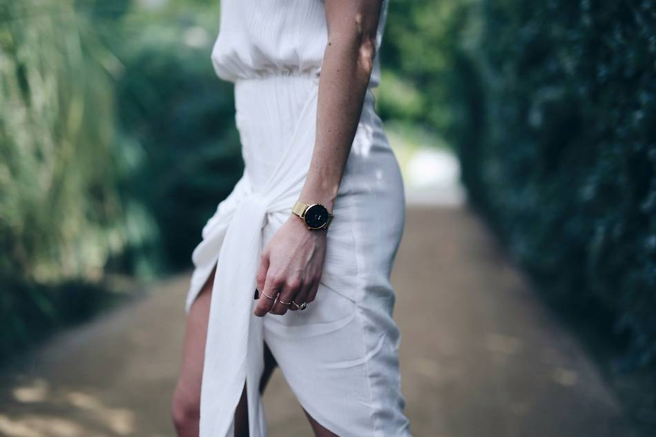 Style and beauty blogger Jill Lansky of The August Diaries what to wear on vacation in white wrap Stylestalker black and gold watch