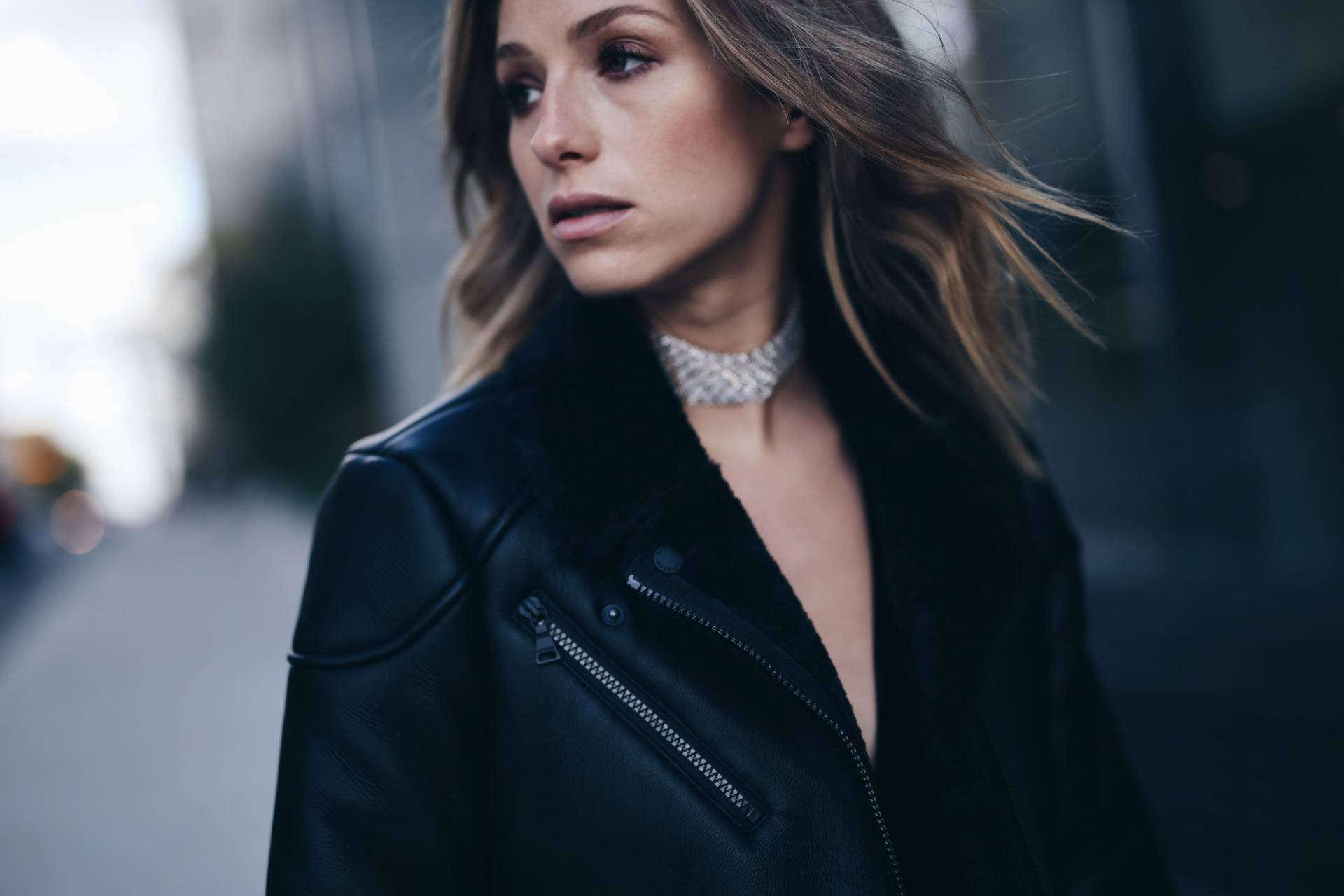 black shearling coat, silver choker necklace