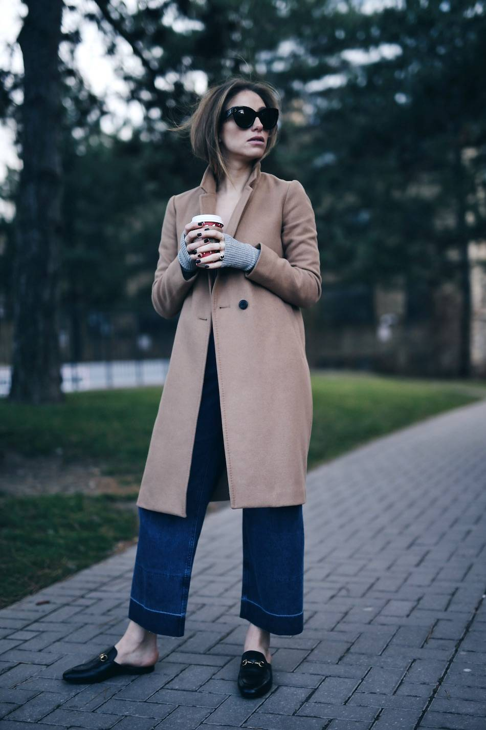 Style and beauty blogger Jill Lansky of The August Diaries in Aritzia camel coat + Gucci slides, Rachel Comey jeans, Celine Caty sunglasses