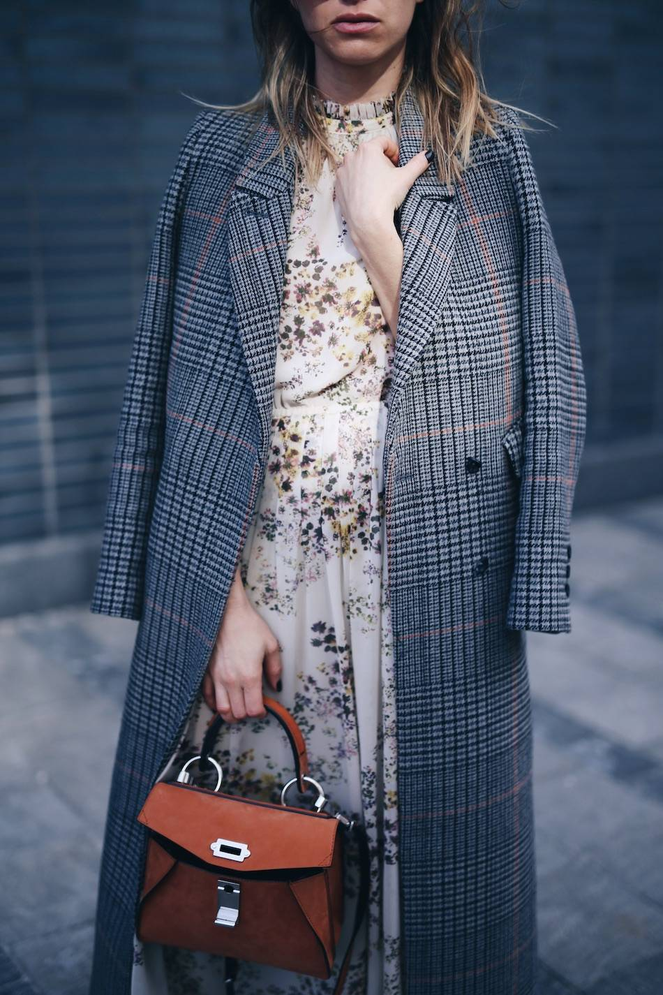 Style and beauty blogger Jill Lansky of The August Diaries on how to layer stylishly in plaid maxi coat, floral dress, Proenza Schouler hava bag