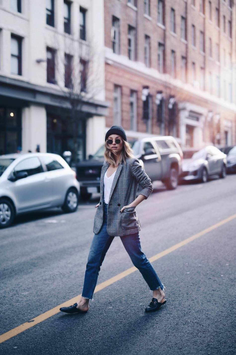 Style and beauty blogger Jill Lansky of The August Diaries on how to take care of luxury bags and shoes in acne studios beanie, boyfriend blazer, how to style gucci black loafers