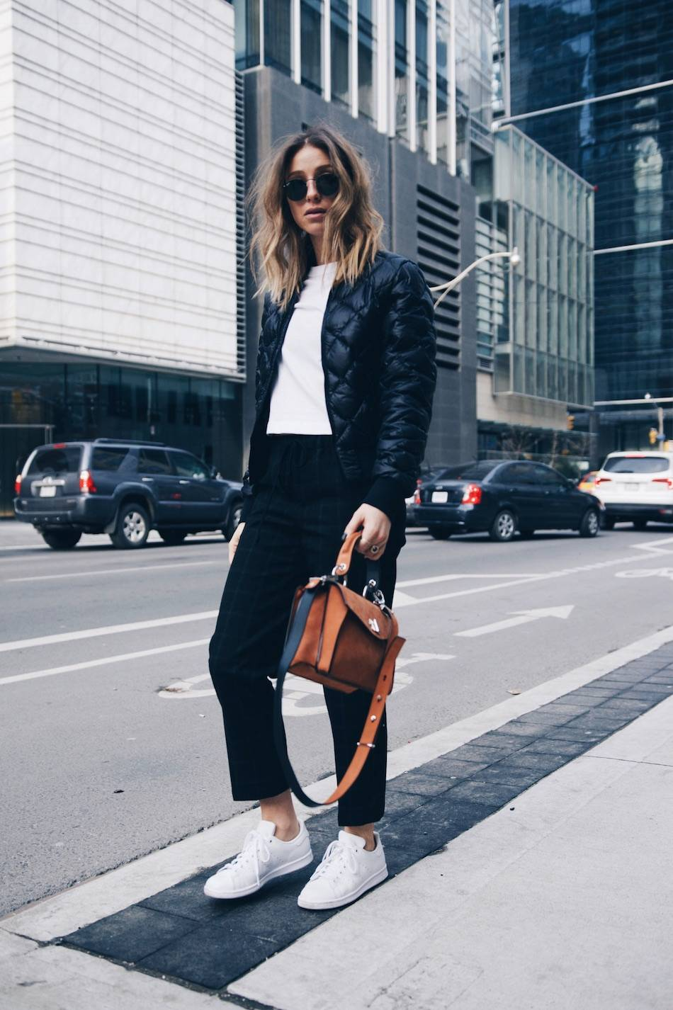 Style and beauty blogger Jill Lansky of The August Diaries on morning routine in athletic fashion trend 2017 Adidas stan smith, bomber jacket, white tee, Proenza Schouler Hava bag