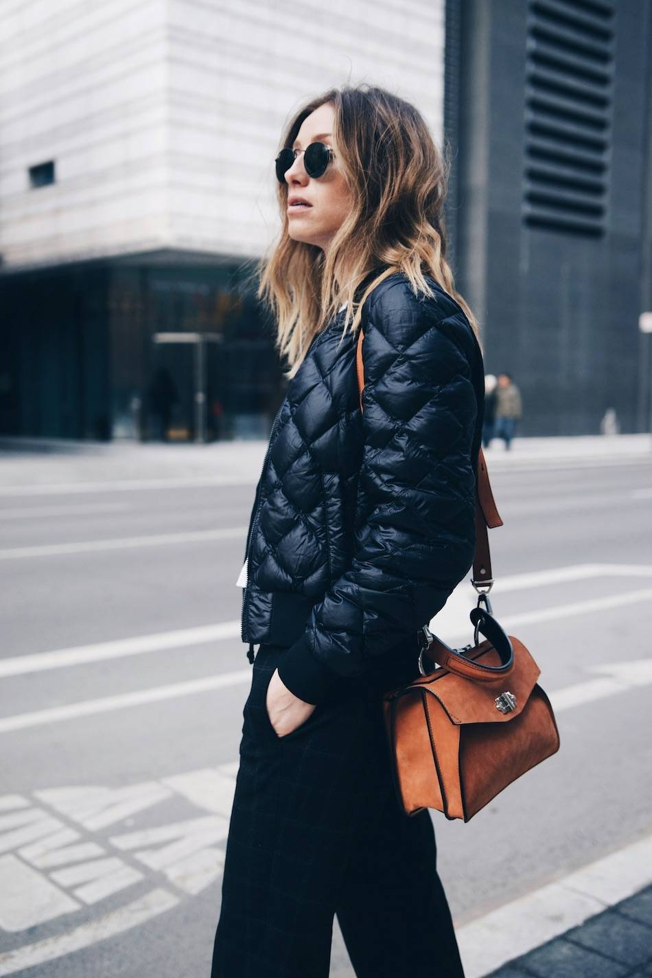 Style and beauty blogger Jill Lansky of The August Diaries on morning wellness routine in athletic trend 2017 bomber jacket, Proenza Schouler Hava bag
