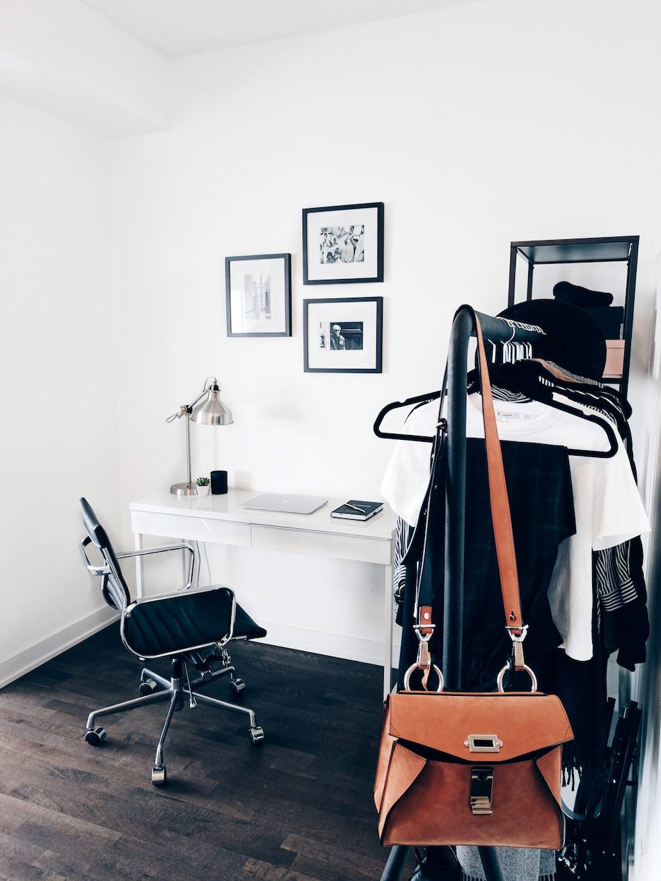 Style and beauty blogger Jill Lansky of The August Diaries shares her simple and minimalist apartment, home office, white desk, gallery wall vintage photographs