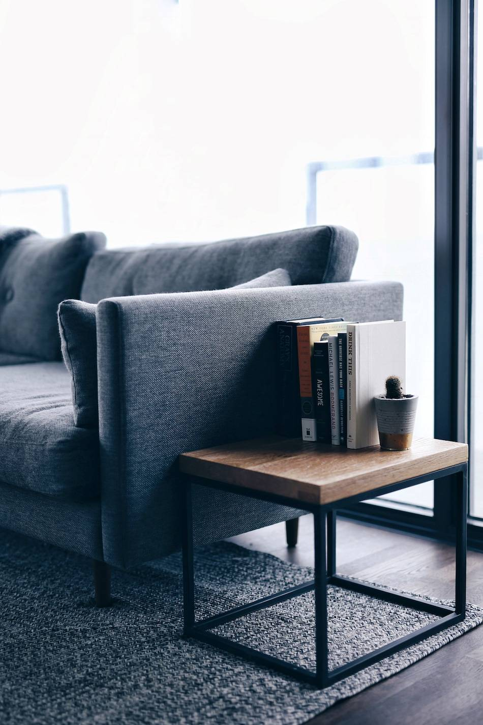 Style-and-beauty-blogger-Jill-Lansky-of-The-August-Diaries-shares-her-simple-and-minimalist-apartment,-interior-inspiration,-Article-Taiga-tables,-grey-couch