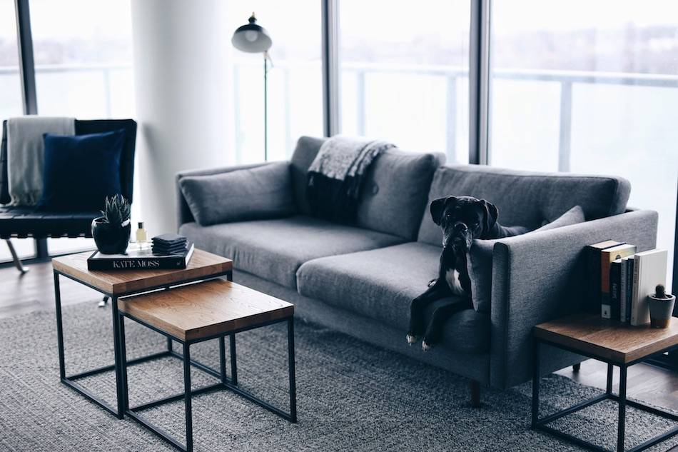 Style and beauty blogger Jill Lansky of The August Diaries shares her simple, minimalistic apartment, interior inspiration, Article wood Taiga tables, grey couch, barcelona chair, grey rug