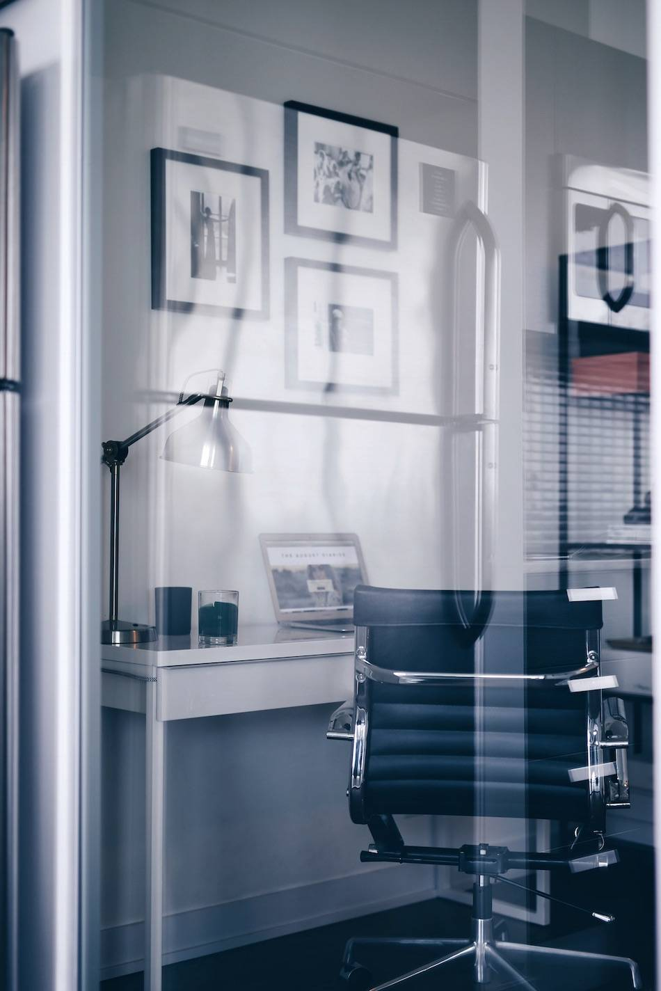 Style and beauty blogger Jill Lansky of The August Diaries shares her simple and minimalist office, interior inspiration, black and silver office chair, black and white gallery wall