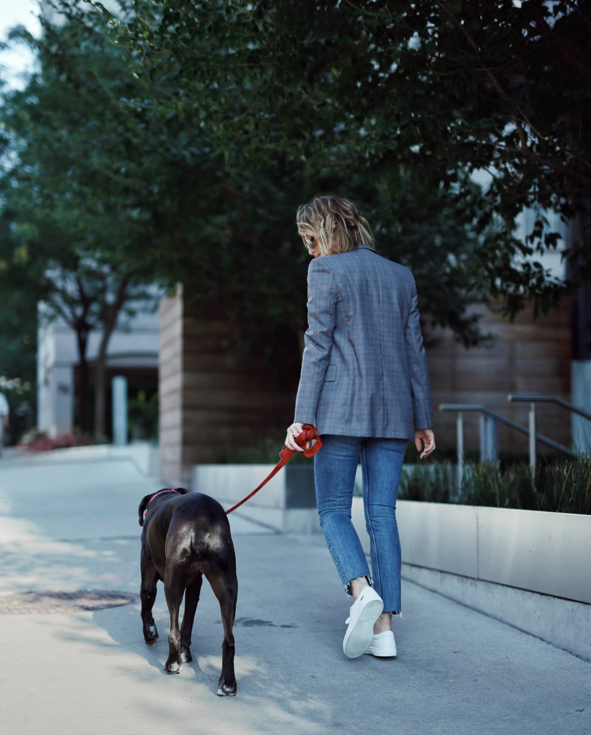 Style and beauty blogger Jill Lansky of The August Diaries walking black boxer