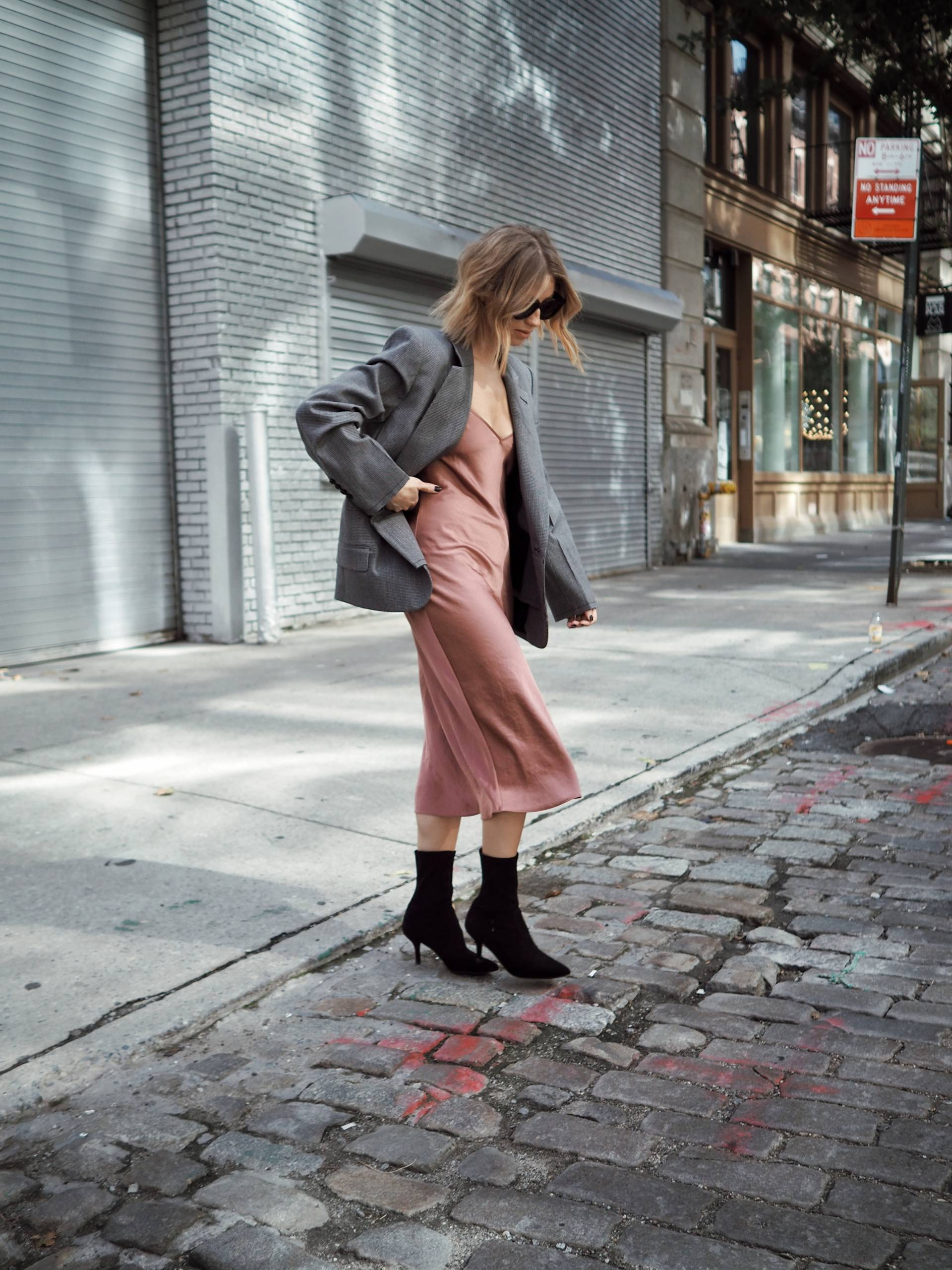 Style and beauty blogger Jill Lansky of the August Diaries in go to fall outfit slip dress, boyfriend blazer, stuart weitzman cling booties