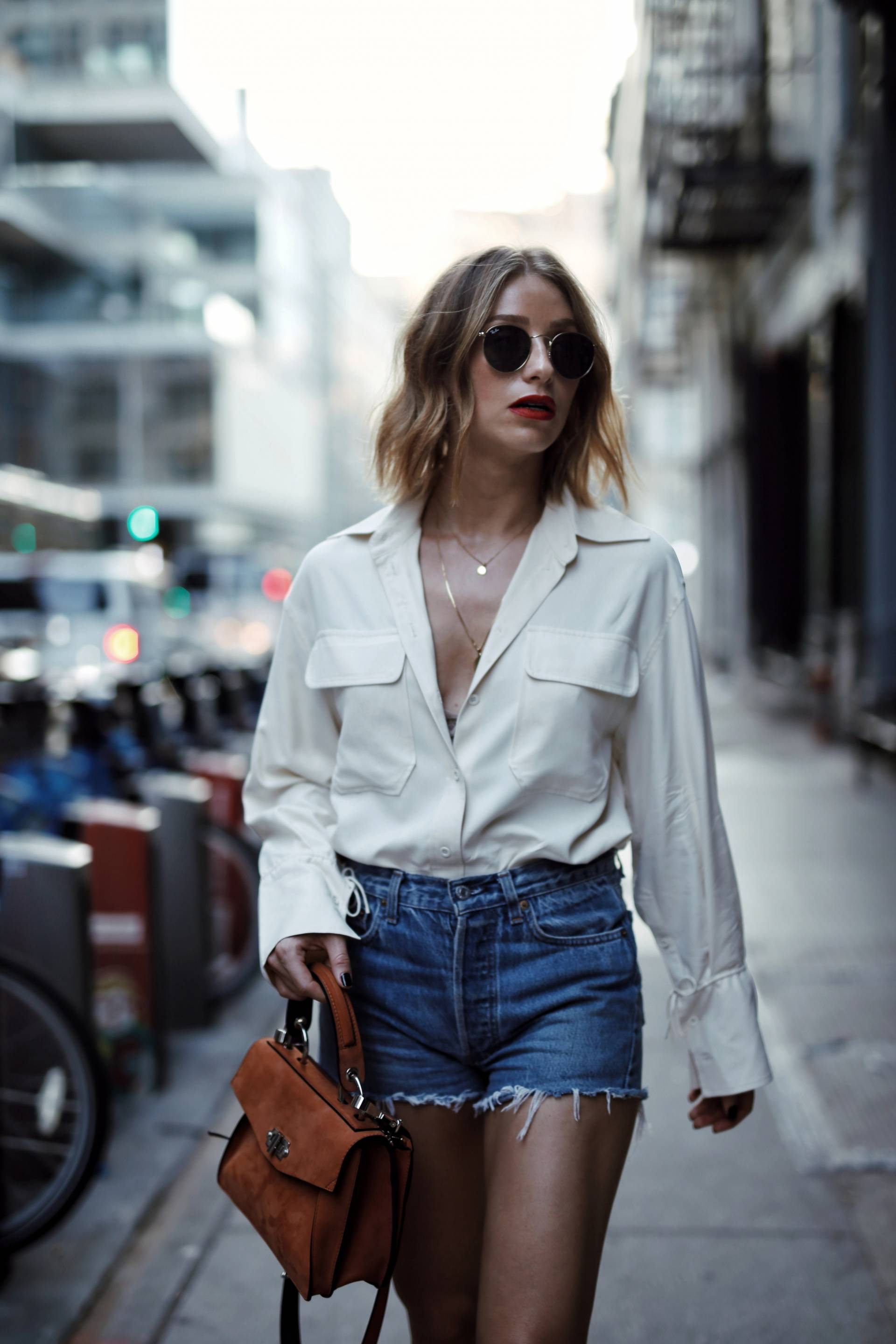 Style and beauty blogger Jill Lansky of the August Diaries on how to dress outside your comfort zone in Aritzia blouse, levi's shorts, proenza schouler hava bag