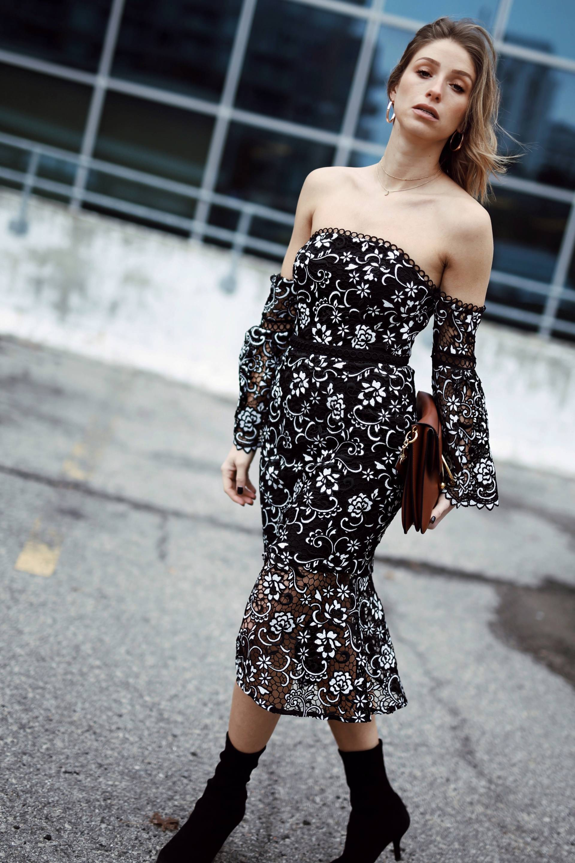 Style and beauty blogger Jill Lansky of the August Diaries on 5 ways to toughen up a dress in floral off the shoulder dress, stuart weitzman clinger boots