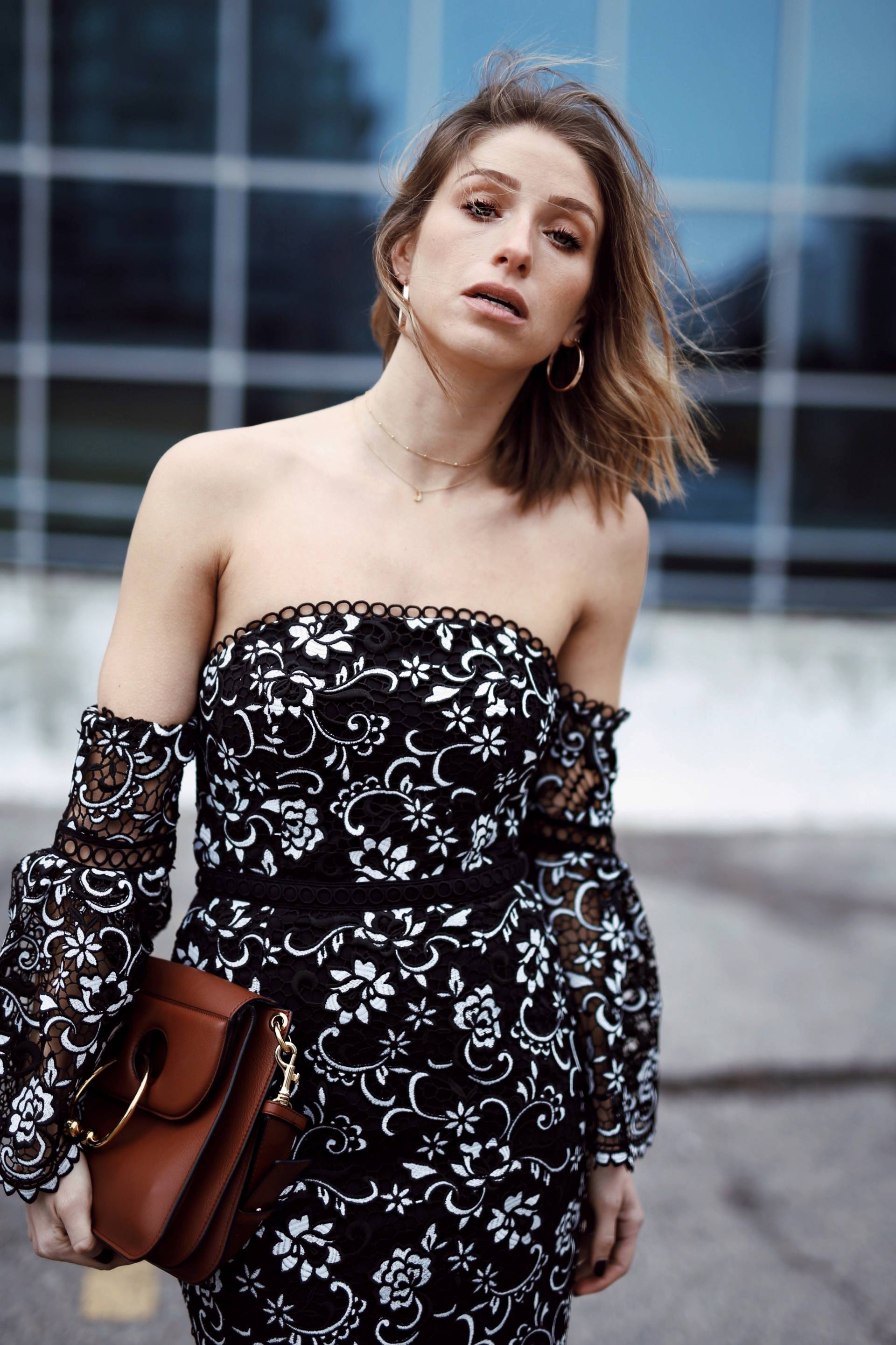 Style and beauty blogger Jill Lansky of the August Diaries on 5 ways to toughen up a dress in off the shoulder dress, hoop earrings