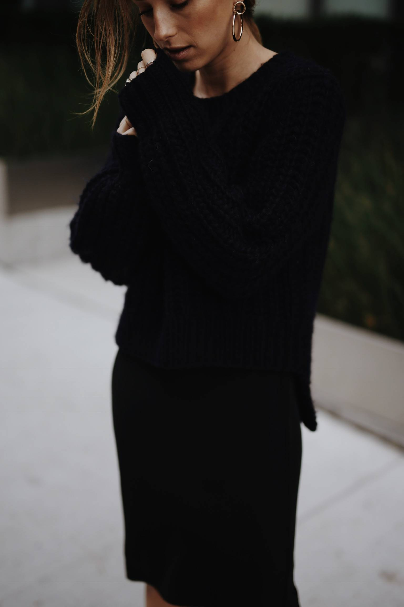 Style and beauty blogger Jill Lansky of The August Diaries shows how to wear black and navy together in a black slip dress and navy knit