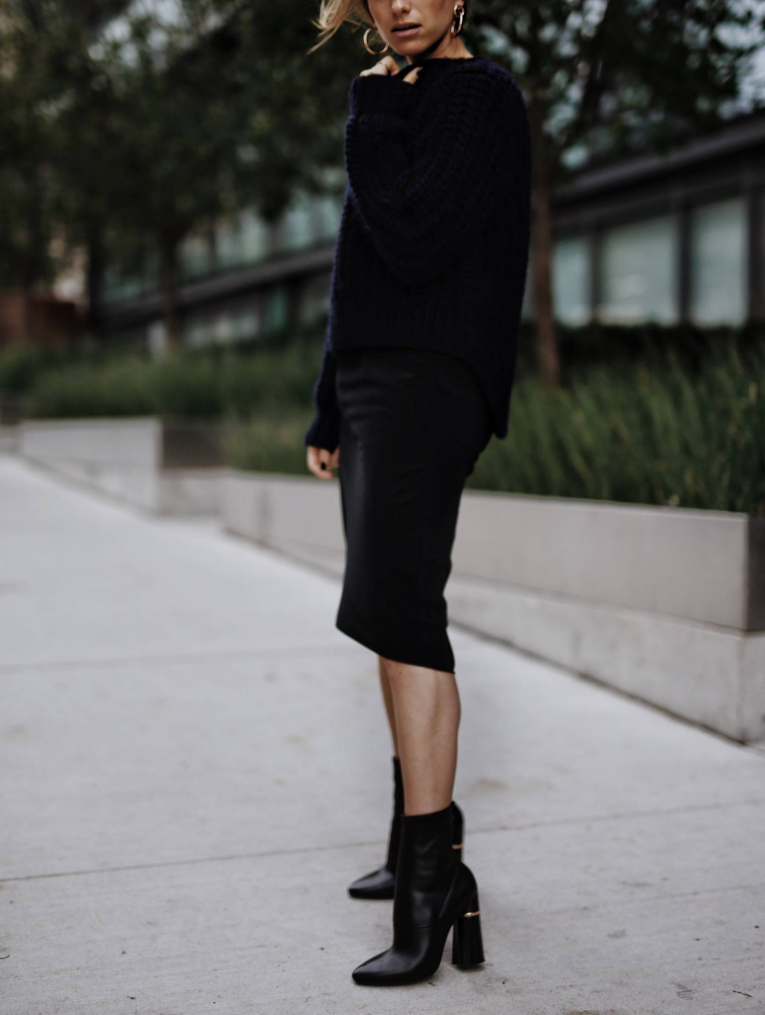 Style and beauty blogger Jill Lansky of The August Diaries shows how to wear black and navy together in a black slip dress and navy sweater with 3.1 Phillip Lim Kyoto boots